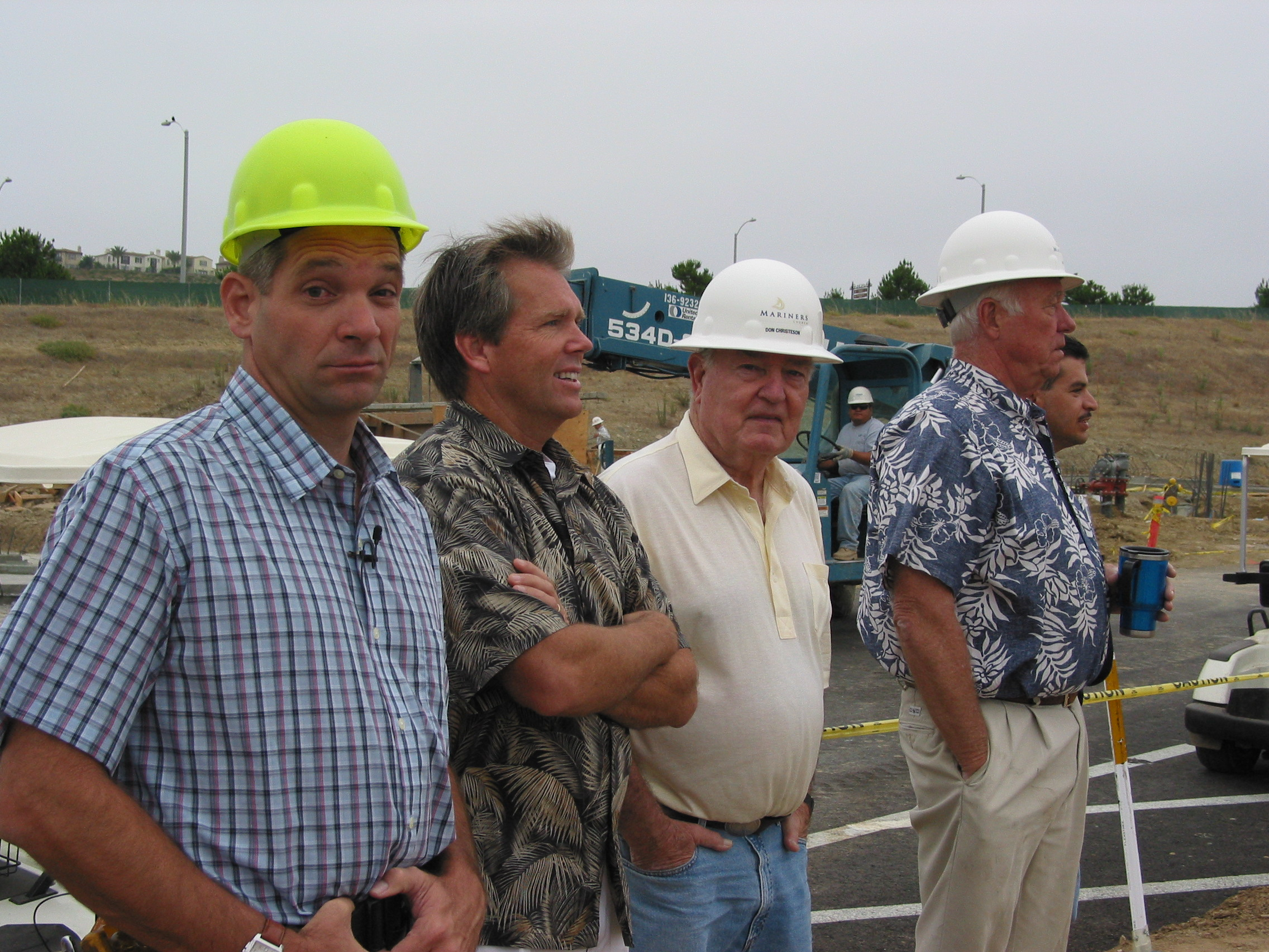 Chuck Wetzel joins Kenton Beshore, Don Christensen and Bob Brogger for the wall raising of the new Post Mariners building.