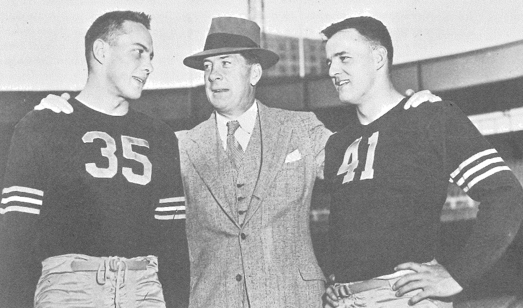 "Army's 1945 backfield stars Felix ""Doc"" Blanchard (35) and Glen Davis (41) flank head coach Red Blaik."